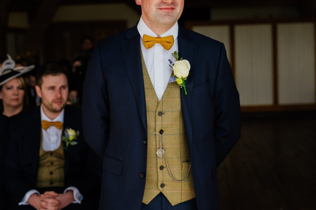 Groom tweed yellow waistcoat and bow tie with pocketwatch