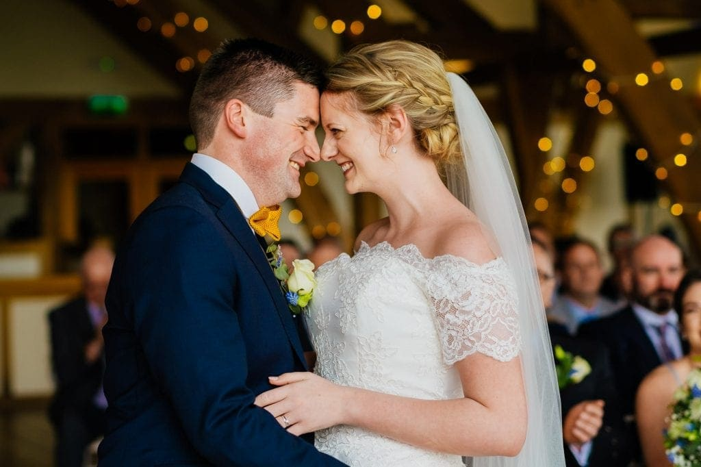 Couple embrace after wedding ceremony