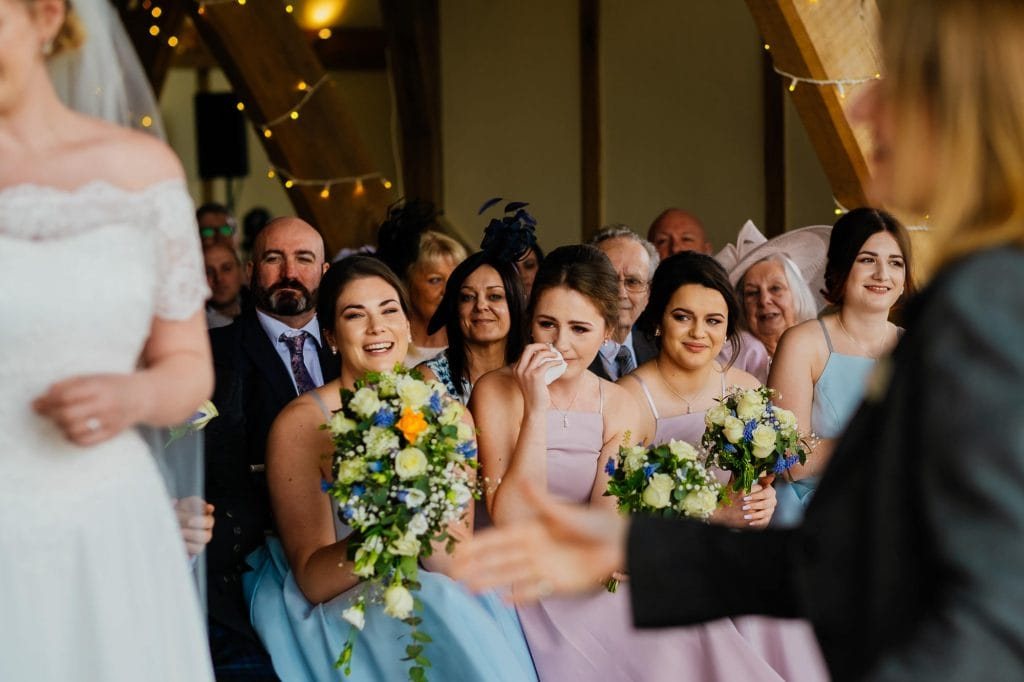 Bridesmaid wipes tears after ceremony