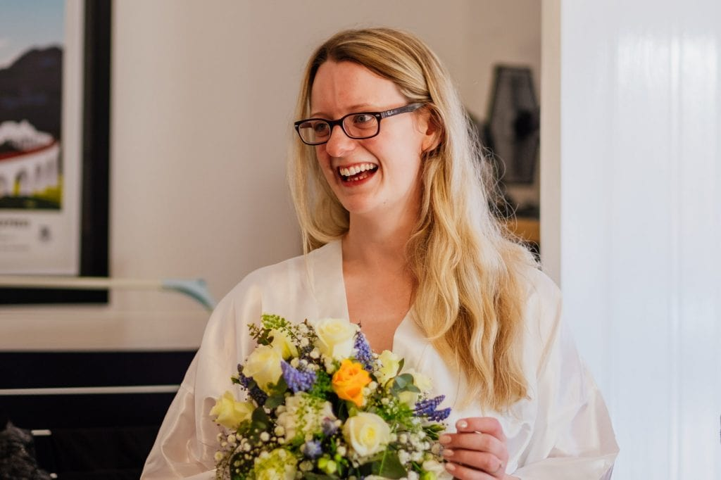 Bride holding flowers before getting ready