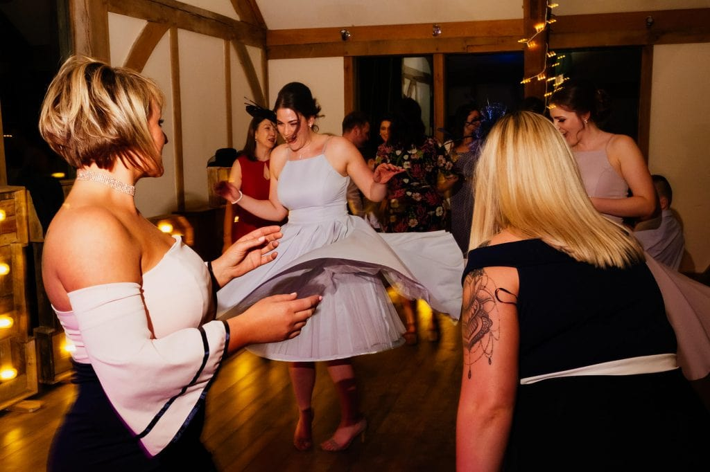 Bridesmaid twirling at wedding party