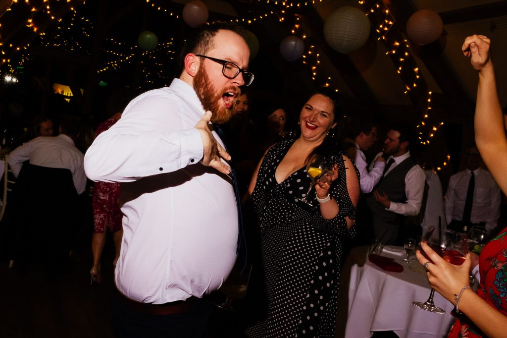 Drunk guest dancing at wedding party