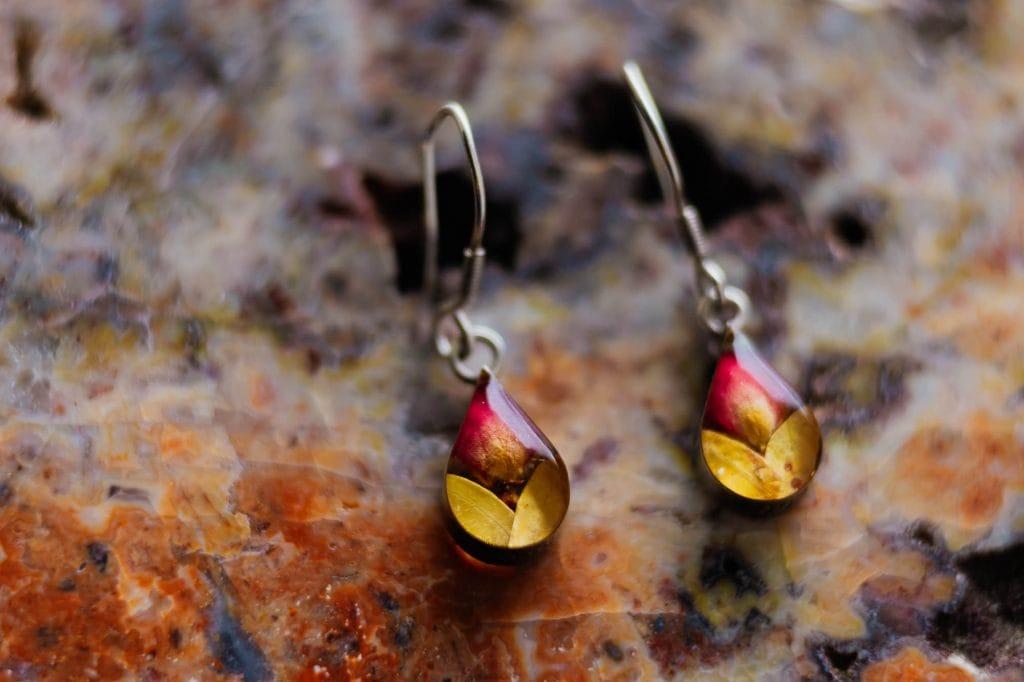 Pressed flower orange and red teardrop earrings