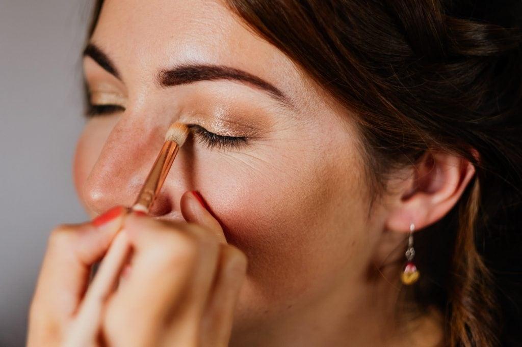 Bride having eyeshadow Applied