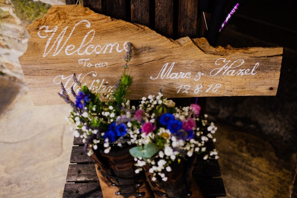 Ceremony welcome sign with walking boots