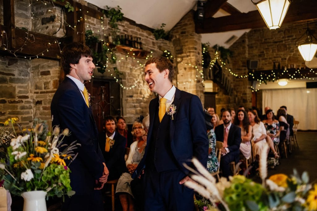Groom laughing in ceremony