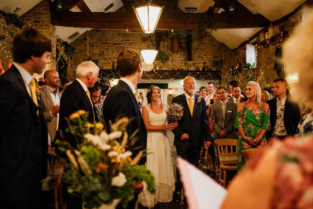 Bride entrances with father