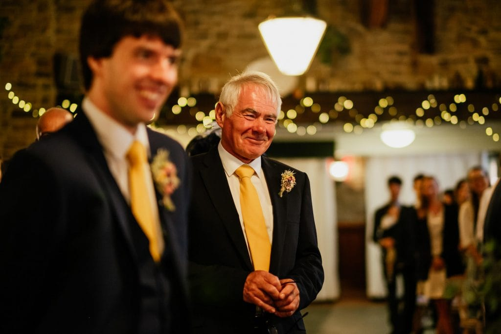 Father of the groom smiling