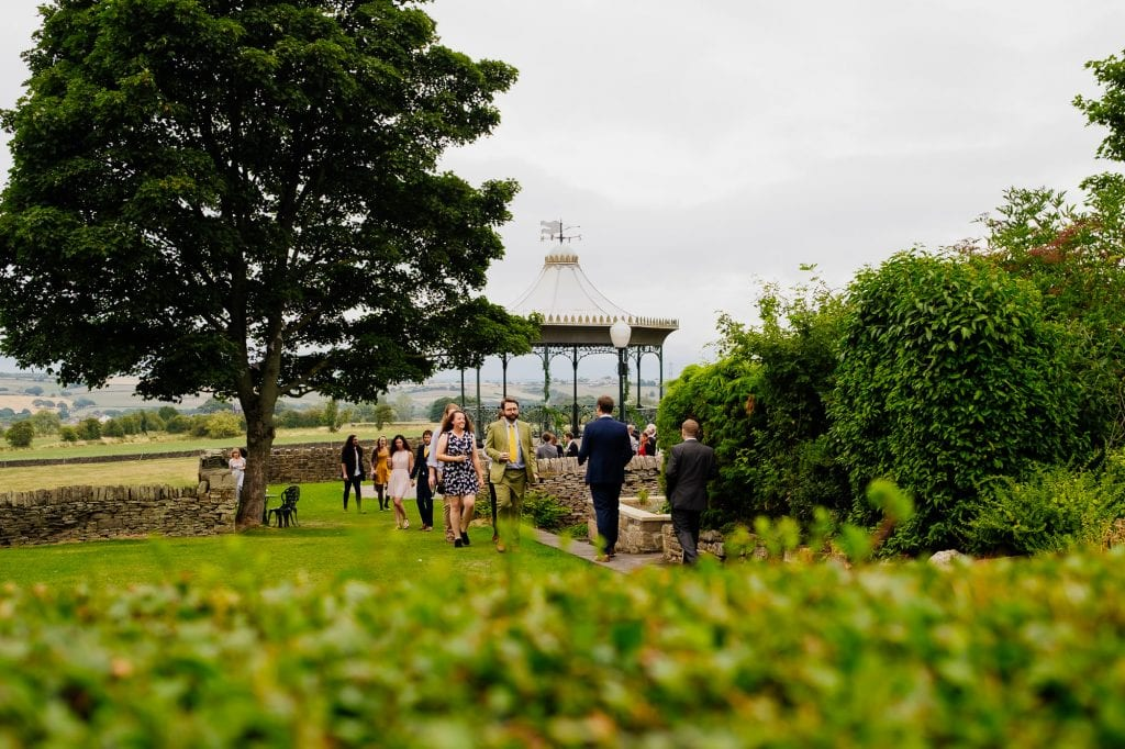 Wedding guests with bandstand