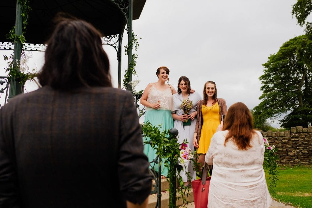 Guests take photos in the bandstand