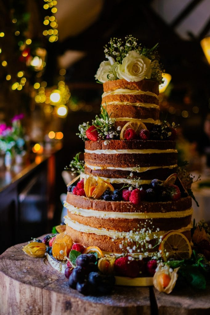 Three tier naked wedding cake with buttercream