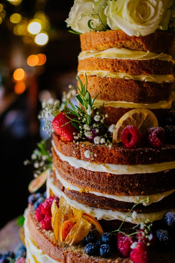 Naked wedding cake with buttercream and fruit