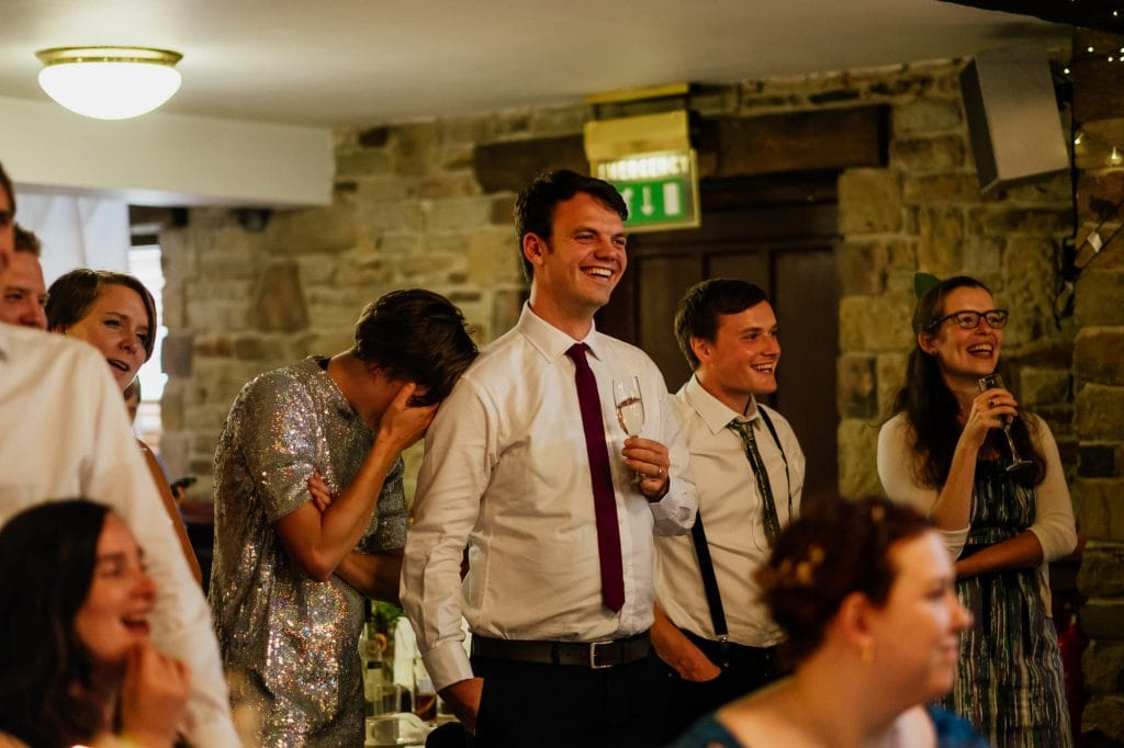 Guests react to wedding speeches
