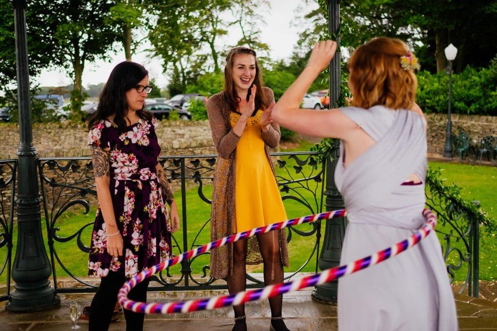 Bridesmaid hula hooping