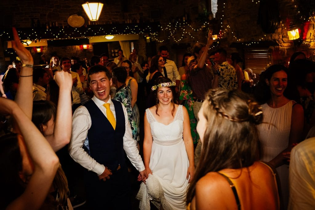 Bride and groom laughing during ceilidh