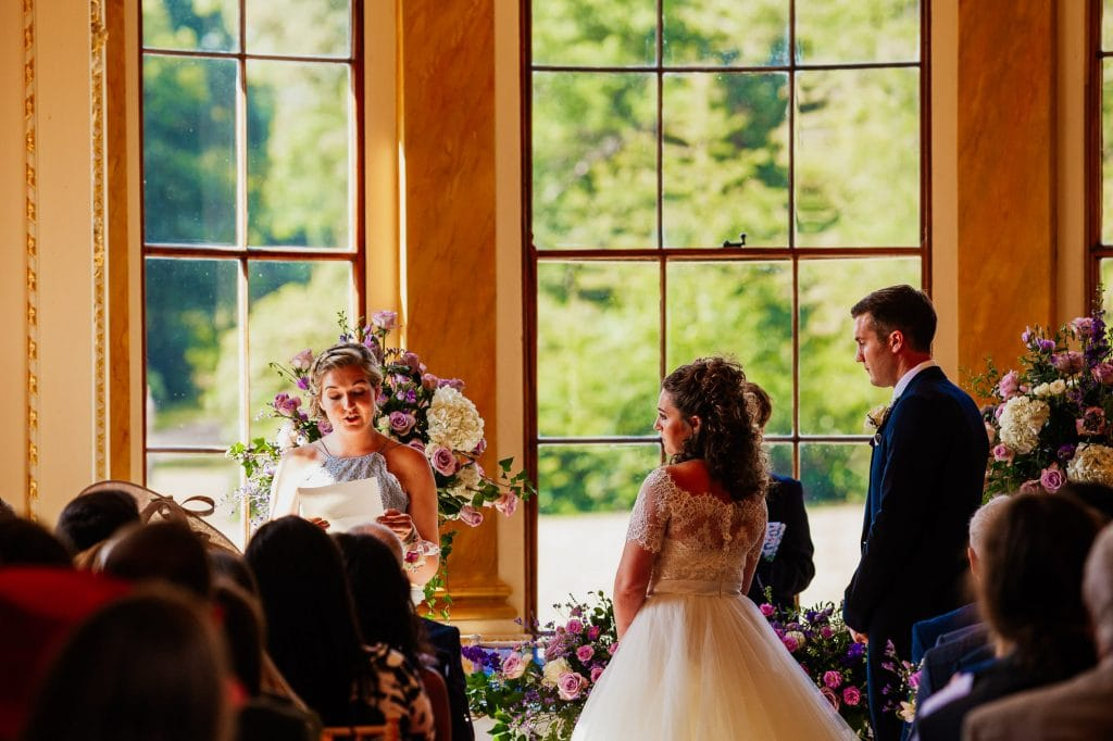 Ceremony reading under large windows