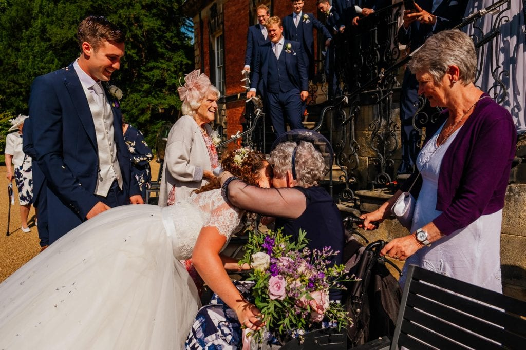 bride hugging grandparents