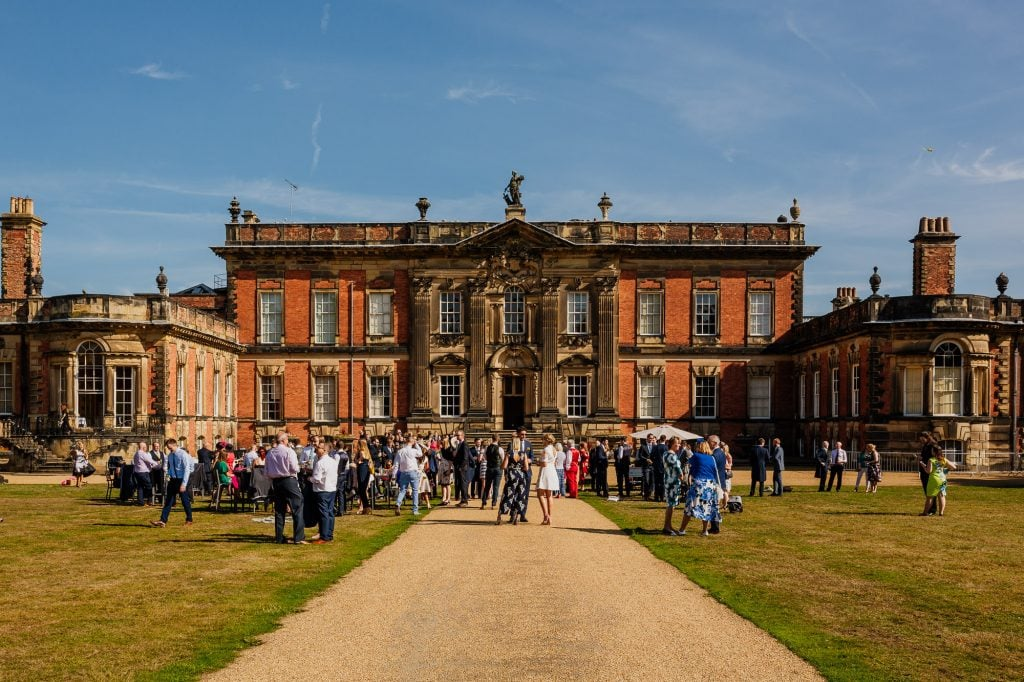 Wedding guests outside grade 1 listed building