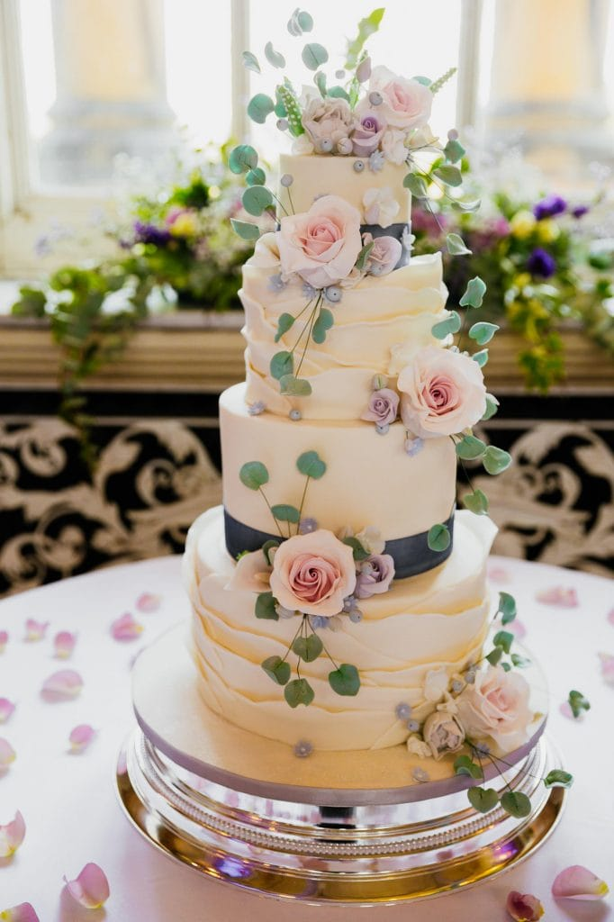 4 tier white wedding cake with icing flowers