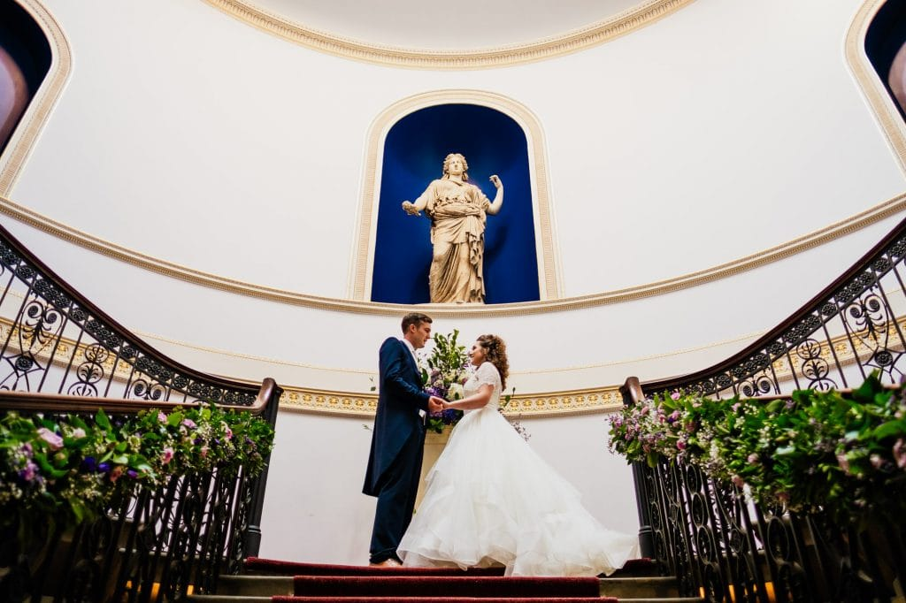 Wedding couple portrait on staircase