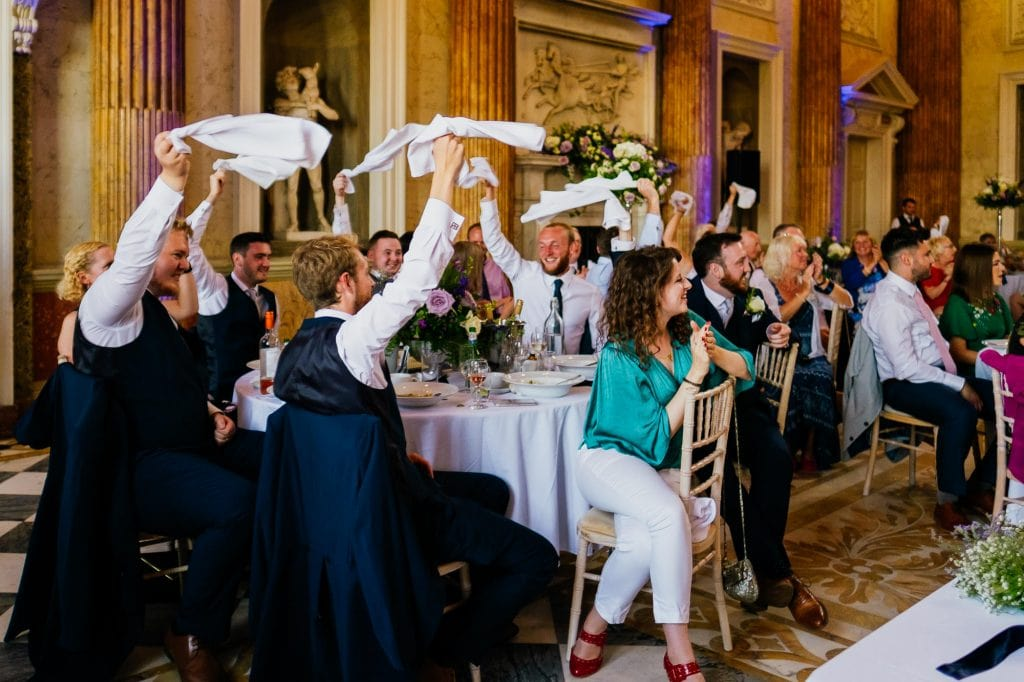 Wedding guests waving napkins