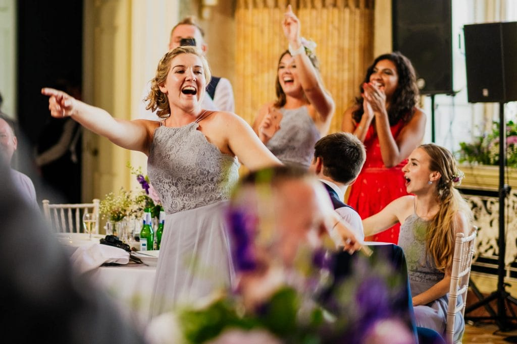 Bridesmaid singing during reception