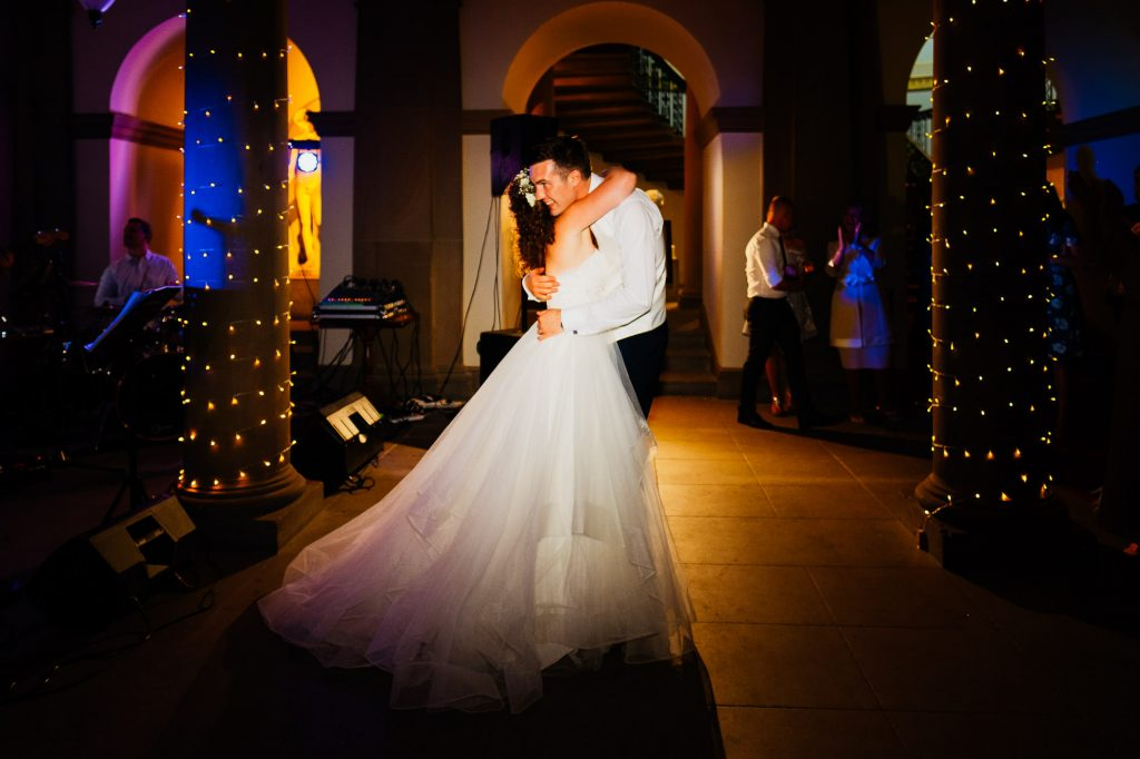 First dance hug with coloured lights