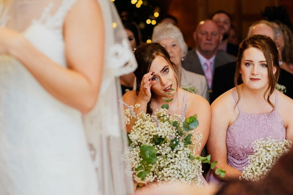 bridesmaid wipes away tears