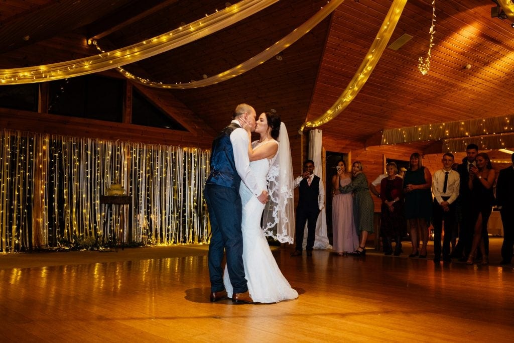 first dance kiss with fairy lights