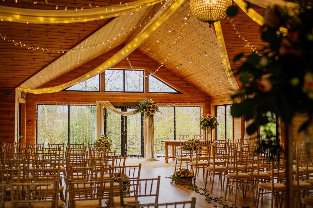 wedding ceremony styling with large windows
