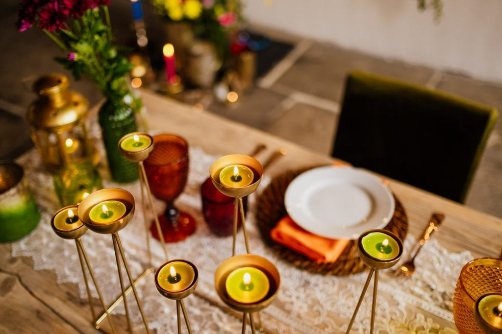 Candle holders on sweetheart wedding table