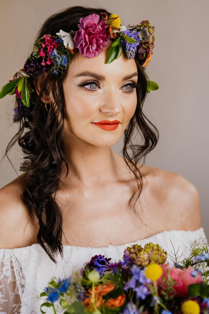 Bride with winged liner and orange lipstick
