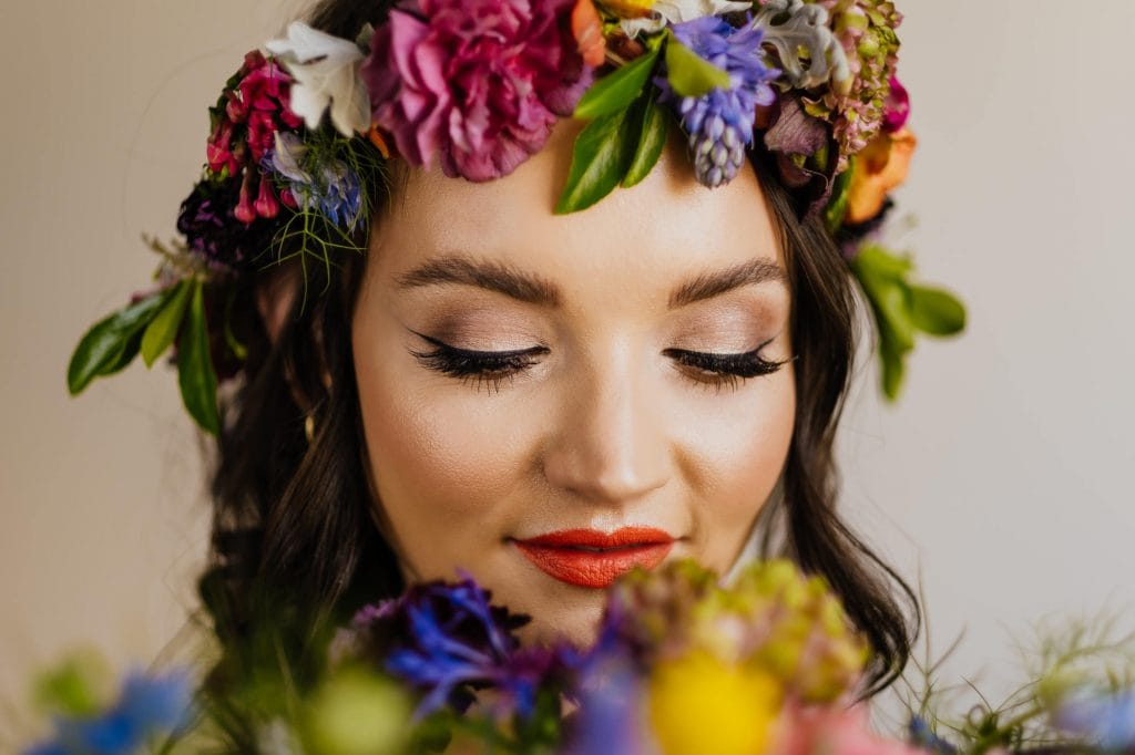 close up bride with crown and flowers