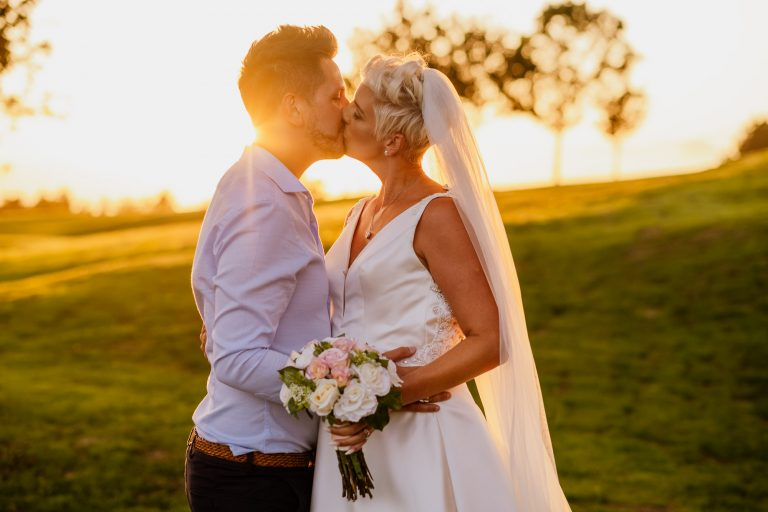 couple kiss at golden hour