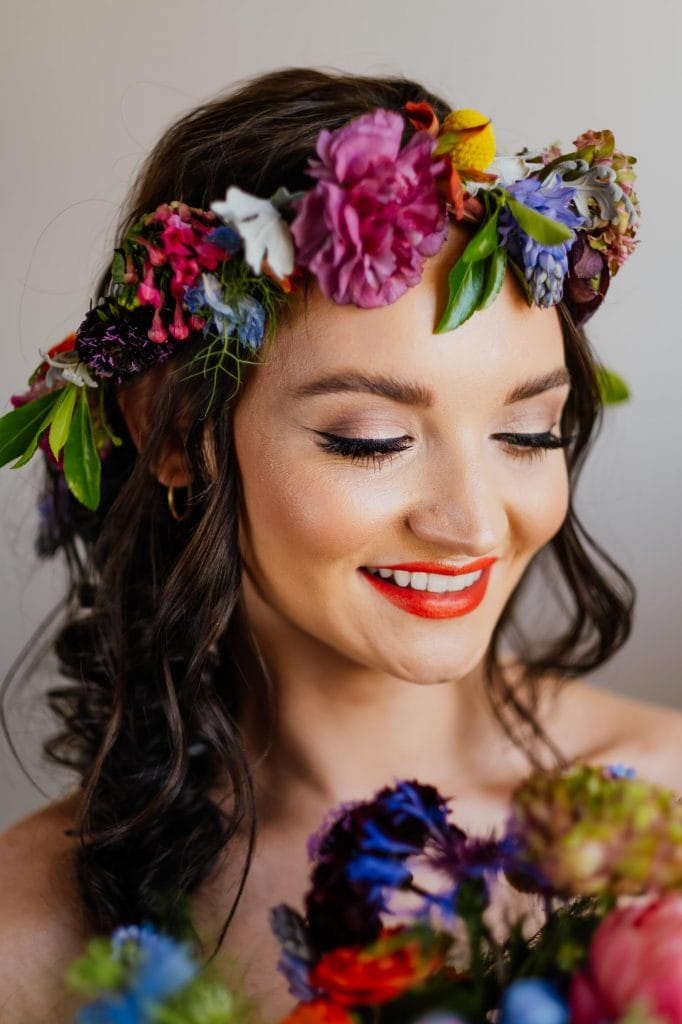 Bride wearing colourful flower crown